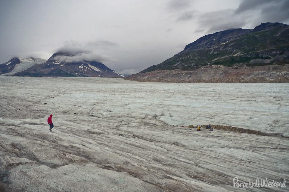 crampons off glacier walkhike backpack