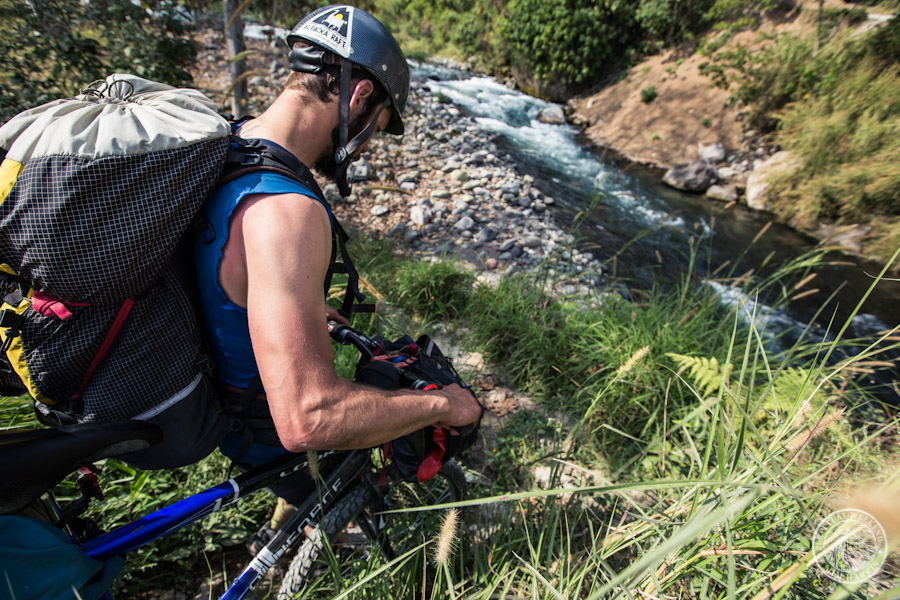 Todd Tumolo hikes his bike down to the Rio Antigua and our packrafting put-in