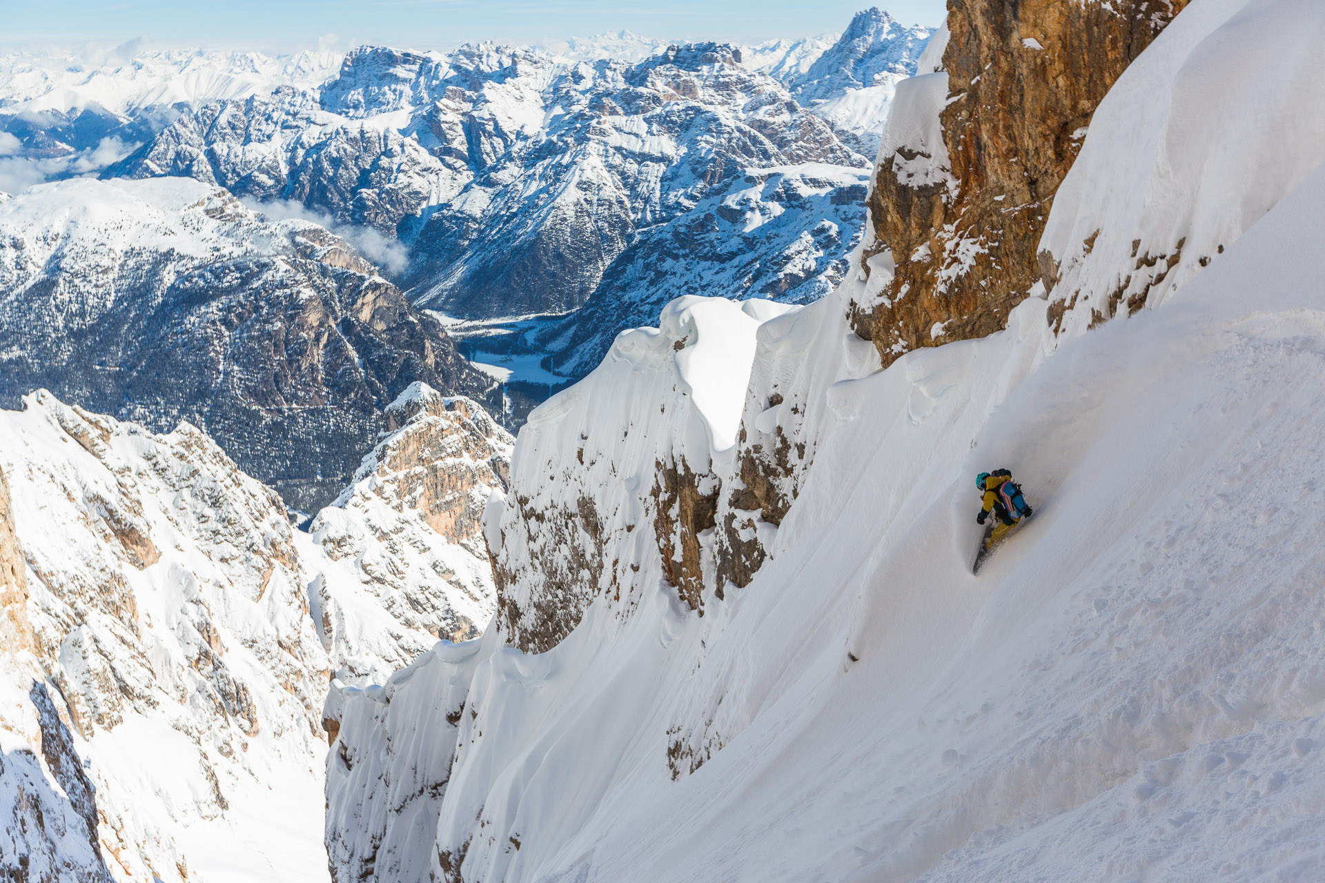 Bibi Pekarek drops into Staunies couloir in the Dolomites