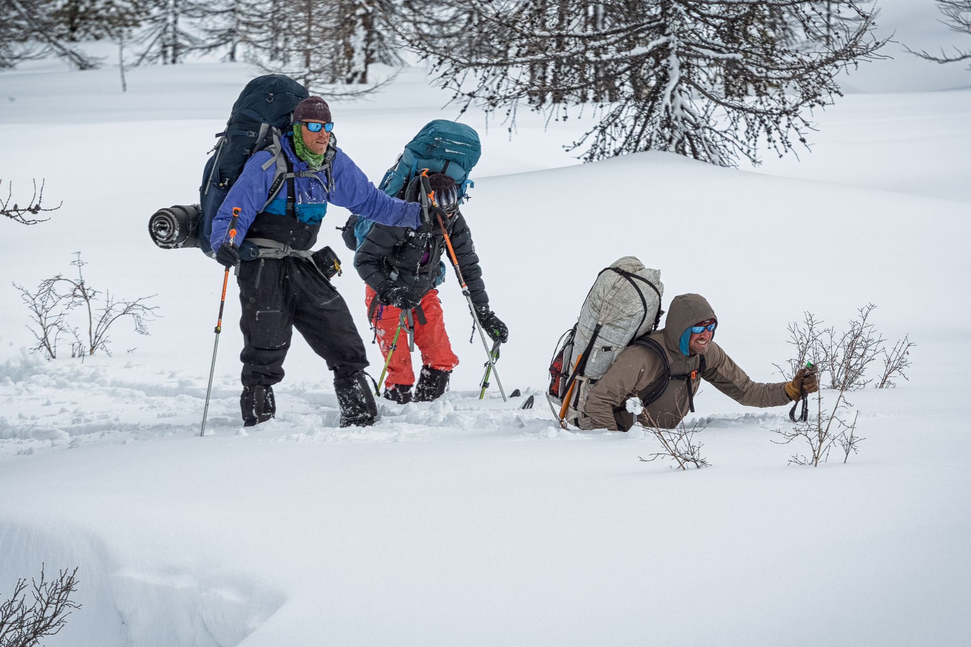After a few feet where the snow was supportable, the person breaking trail would suddenly drop 2 or 3 feet through the weak loose snow grains below. It made for frustrating, tiring, and slow travel. Forrest McCarthy wallows while Jason Wilmot and Rebecca Watters look on.