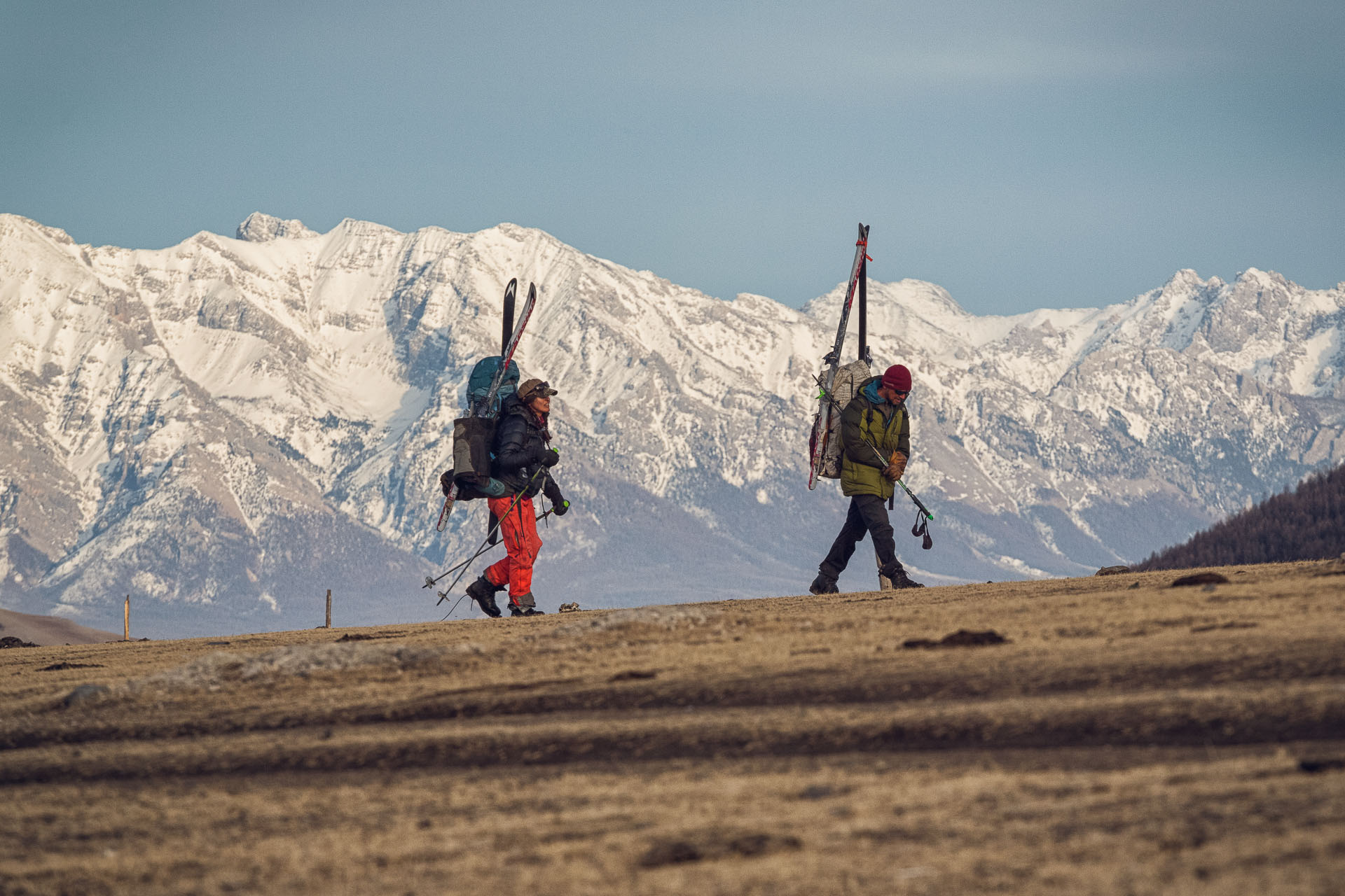 Rebecca Watters walks with Forrest McCarthy with the Horidol Sardag Protected Area behind.